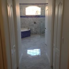 Florida Bathroom With Carrara Marble And Glass