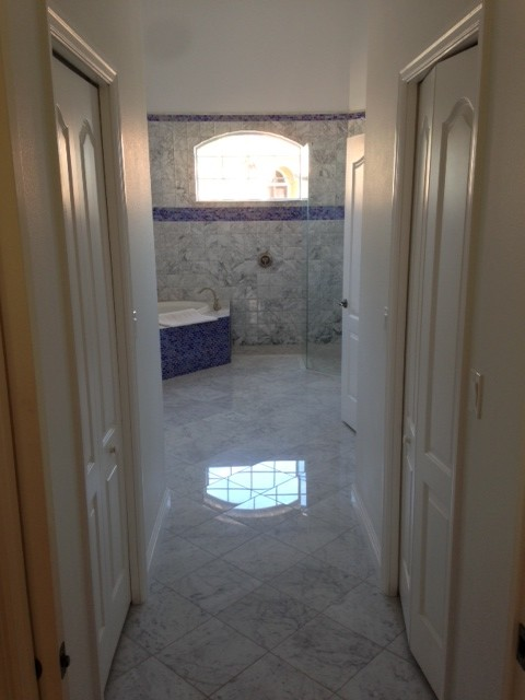 Florida Bathroom With Carrara Marble And Glass